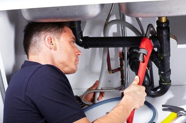 plumber-repairs-sink